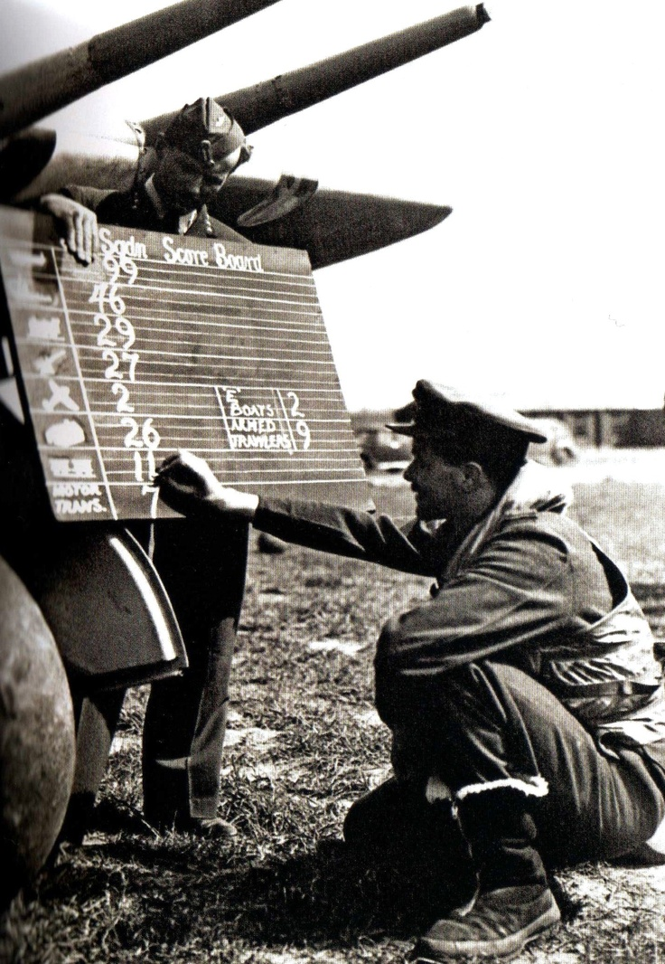 An RAF pilot chalks up the score of his Hawker Typhoon Mk 1B aircraft on the Squadron board, 6 June 1944