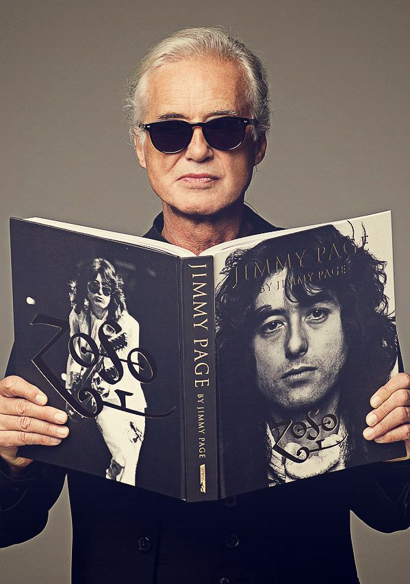 givemepage:  Jimmy Page holding his photobiography, October 2014.
