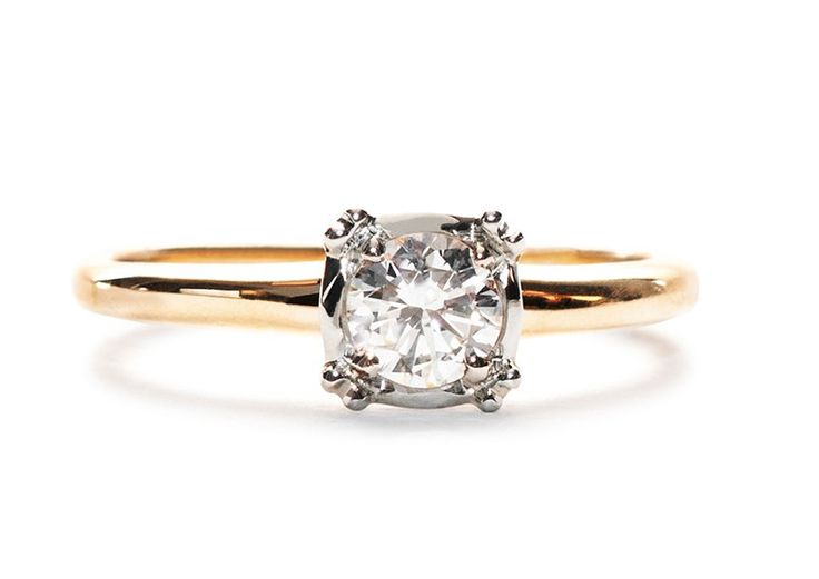 Wadesboro is a simple vintage engagement ring centering a .38ct Round Brilliant Cut diamond with a 14k yellow gold band. This pretty, low profile ring is lovely and timeless! | Trumpet & Horn | $2,900