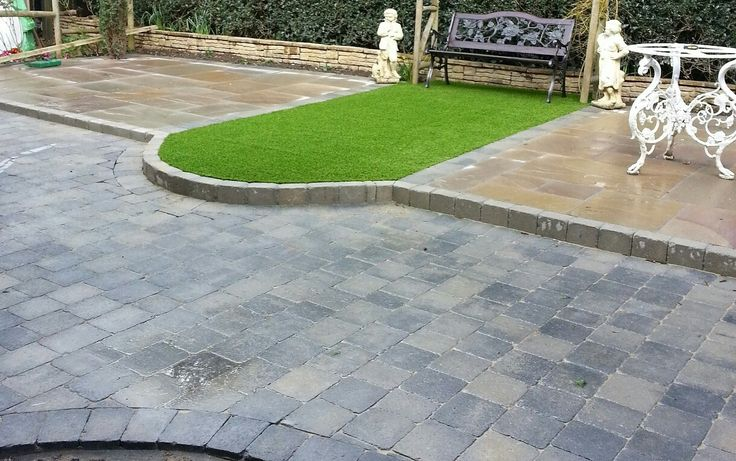 As well as amazing paving, artificial grass adds that splash of colour as well as keeping the maintenance low.