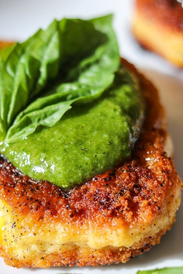 Delicious Parmesan Pork Chops with Pesto. So tender and juicy, you won't ever ha