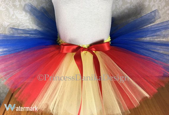 Do you have a school function you would like to dress up for or even a fun run 5k like the Zombie Run, Turkey Trot or a Color Run?! Then this tutu is for you!! This Tutu is perfect for many occasions including holidays, dance classes, photo props, dress up, birthday parties and so much more!  The tutu is made with 3 layers of soft tulle and is hand tied onto a premade crochet band which is very stretchy. 👀 The tutu may appear small first out of the package but the waistband is super…