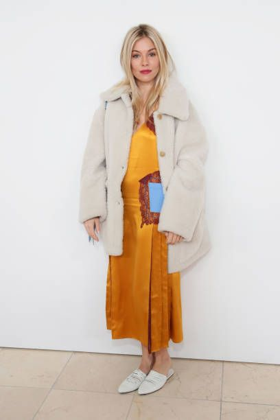 6fd7ee191bf8 Actor Sienna Miller attends the Tory Burch Fall Winter 2018 Fashion Show  during New York Fashion Week at Bridge Market on February 9 2018 in New York .