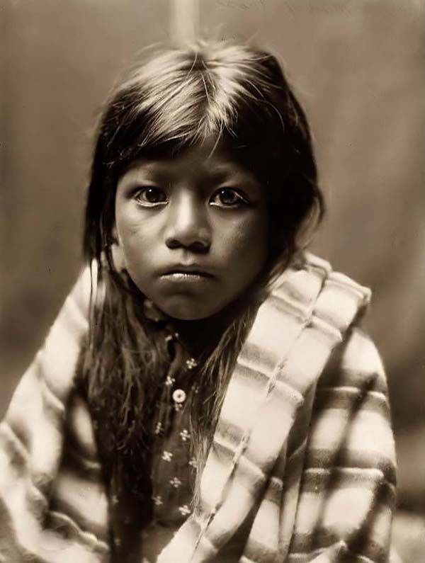This photograph was taken in 1905, and shows a young Native American child. The photograph was taken by Edward Curtis.