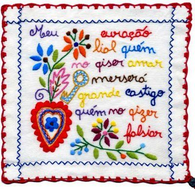 Love the message...  even though the spelling is a lil' off... Lenço dos namorados.  Portugal (lovers embroidery scarves)