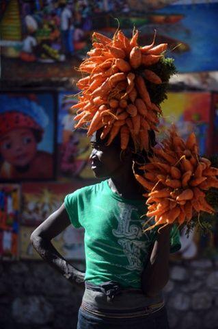 A woman sells carrots Port-au-Prince