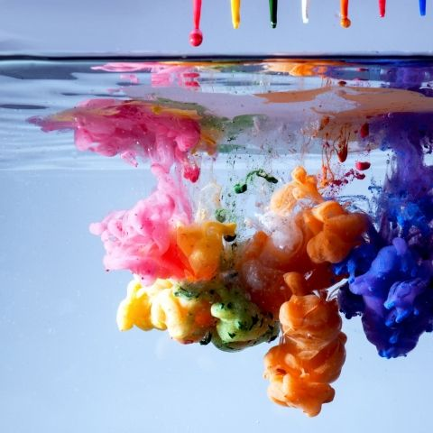 Beautiful close up of color dispersing in water: