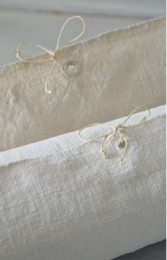 French linen Natural  Cream available on FRAGMENTS IDENTITY furniture collections, soft goods and one-of-a -kinds.