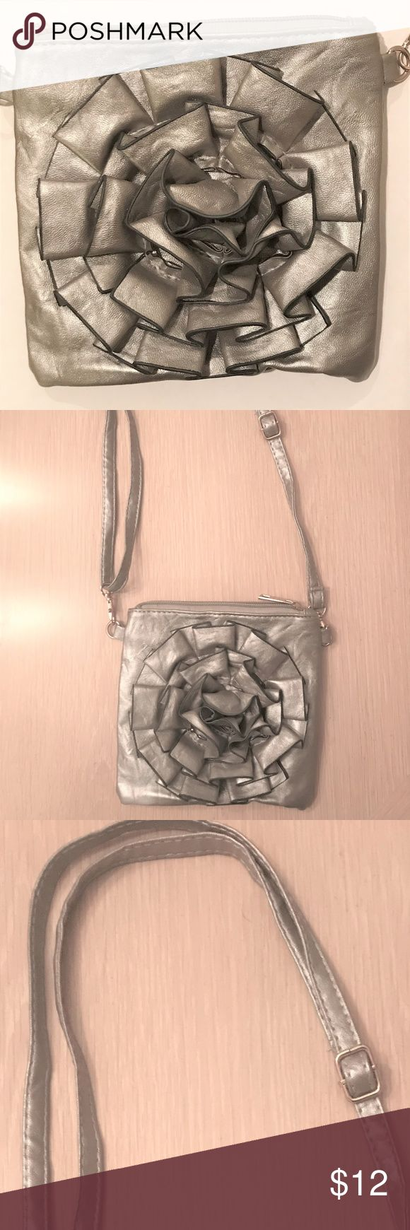 """SAX Silvery Grey Floral Shoulder Bag This is a floral shoulder bag with adjustable strap. It has a silvery grey color. It has inside and outside zippered pockets and a deep inside pocket. It is in mint condition except for the outside zipper which has a black spot, see last photo. It measures 7x7"""". SAX Bags Shoulder Bags"""