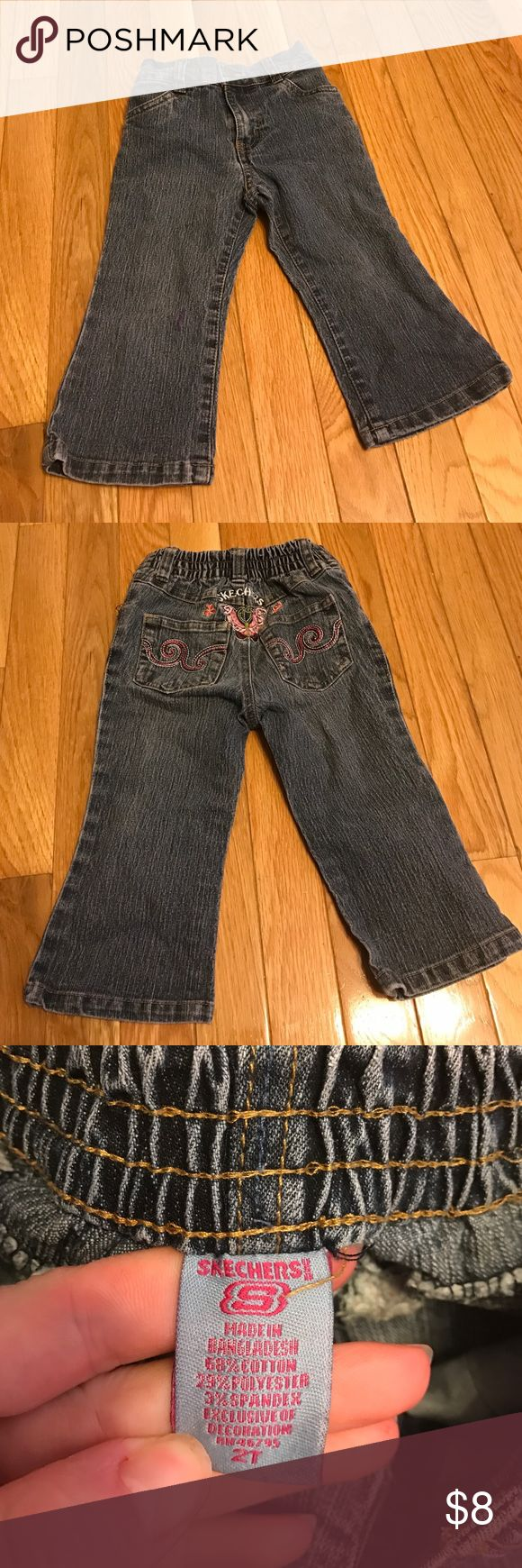 Girls Skechers jeans size 2t Girls size 2t Skechers jeans. Purple stain on front right leg (picture). Otherwise in great used condition, no tears or rips Skechers Bottoms Jeans