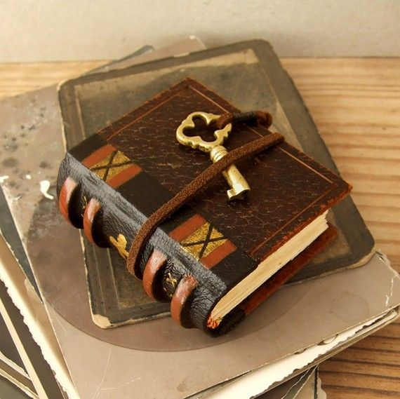 Itty bitty leather hand made journal with a key! CUTE I want!!!
