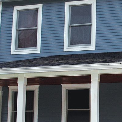 fiber cement in robin's-egg-blue on second-story, pricier cedar clapboards just on portion sheltered by the porch.