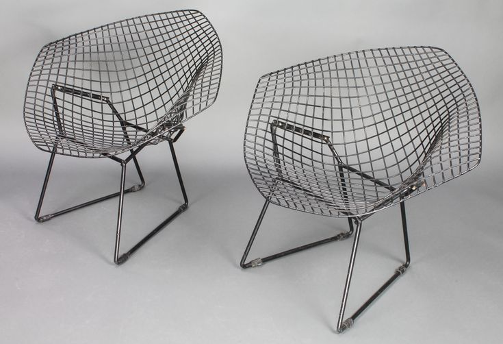 Lot 1028, In the manner of Harry Bertoia, a pair of black painted diamond chairs est £280-320