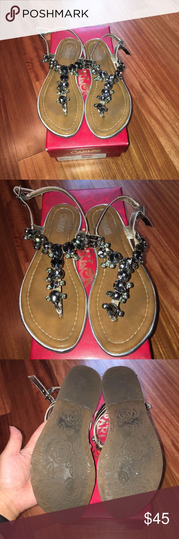 Carlos Santana Marquee Pewter Sandals Worn once then kept in box and never wore again. These sandals are absolutely beautiful but I need to clear out my closet. I wore them for a beach vacation and the stones sparkled under the sun. The stones are all attached and flawless. Perfect neutral color to wear with anything. If I don't sell then I'll keep it. 😂 adjustable strap. Comes with original box! Carlos Santana Shoes Sandals