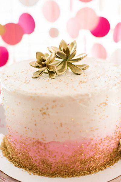 Gold glitter and succulent topped ombre cake: http://www.stylemepretty.com/living/2015/03/09/flamingo-first-birthday-bash/   Photography: Brooke Images - http://www.brookeimages.com/: