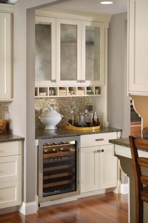 Separating the family room from the kitchen is this great mini butler's pantry/dry bar. What a fantastic idea. by ginger