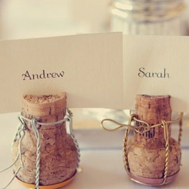Champagne corks are super cute as place cards at a party!  So clever!