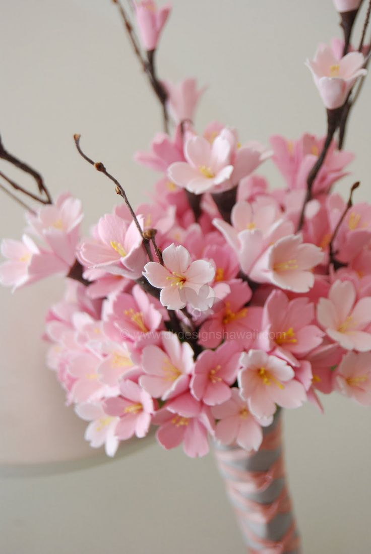 Bridesmaid cherry blossom bouquet. Would be perfect with some red.