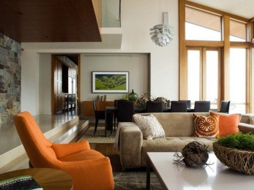 The orange chair and pillows go great with the douglas fir trim
