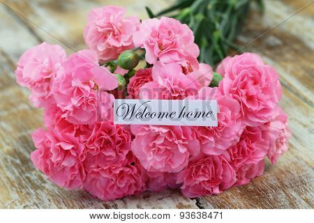 Image of Welcome Home Card Pink Carnations Rustic Wooden Surface