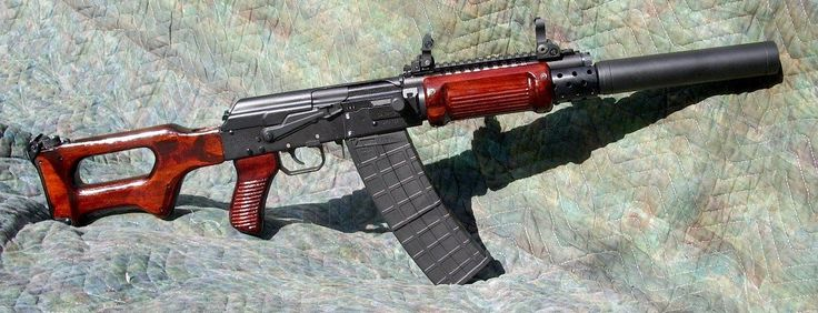 Custom Saiga-12 Really interesting mix of parts. Owner modified a PKM stock to fit onto the Saiga's rear trunnion, then modified an Israeli FAL handguard for the front. Pistol grip looks like a homemade version or could be an original wooden pistol grip with the grooves added later. I kind of like the weirdness of it.