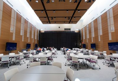 The forum has retractable seating that allows it to convert from a public lecture space to a flat-floor learning space. Photo by Riley Brandt, University of Calgary