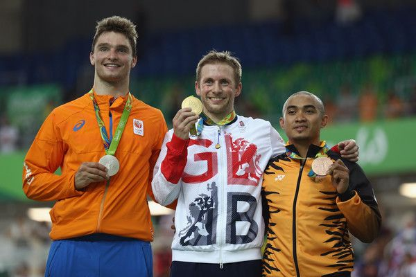 Silver medalist Matthijs Buchli of the Netherlands, gold medalist Jason Kenny of Great Britain and bronze medalist Azizulhasni Awang of Malaysia celebrate during the medal ceremony after the Men's Keirin Finals race on Day 11 of the Rio 2016 Olympic Games at the Rio Olympic Velodrome on August 16, 2016 in Rio de Janeiro, Brazil.