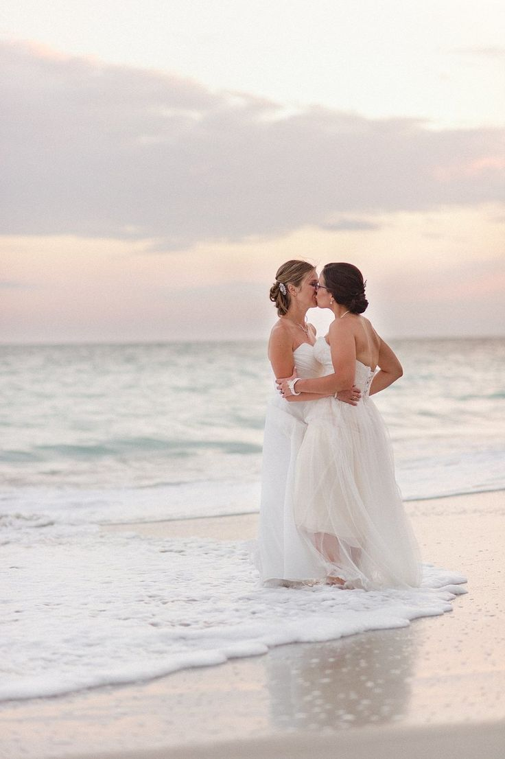 Beautiful brides! Click to see more of their beach wedding.