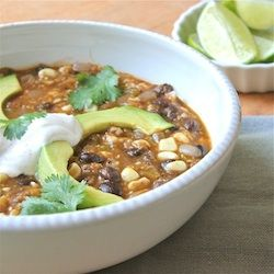 Hearty soup of black beans, tomatillos, corn, and tomatoes, topped with avocado, lime, cilantro, and chipotle sour cream.
