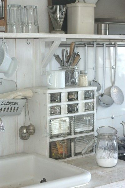 Kitchen sink.~~>I neeed to KNOW what that thing is next to the SINK!!? How coooool is that? I think its' a cabinet that holds square glass measuring cups????