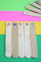 Label Popsicle sticks 1-20 and label three with +, -,=. Let children practice making addition and subtraction facts.