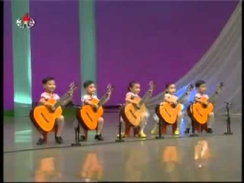 NORTH KOREAN KINDERGARTENERS  It helps to start musical training at an early age. Kids can absorb new information very quickly. This quintet of guitar-playing tots is a good example. You'll be amazing by their performance. Plus, they're incredibly adorable