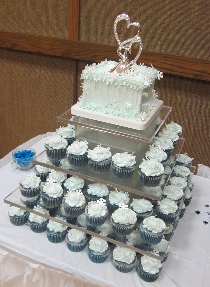 snowflakes adorn these cupcakes on our square cupcake stand cakes by