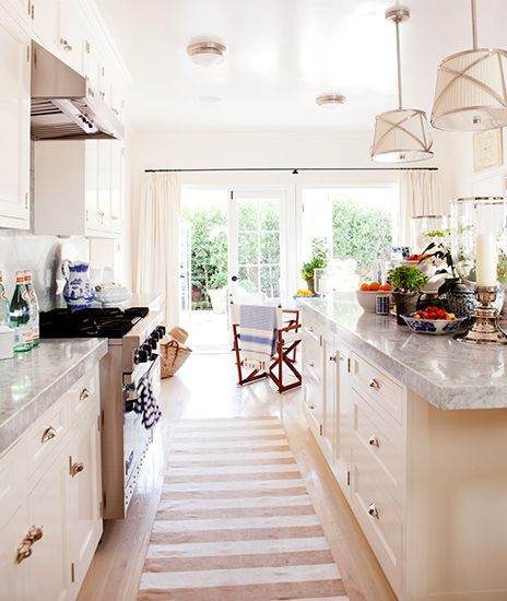 Open & airy kitchen. Love the striped runner!