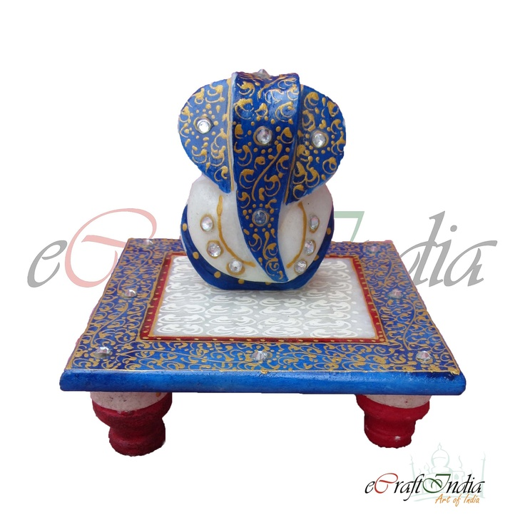 A miniature Ganesha statue made from pure white Rajasthan marble from the house of eCraftIndia.