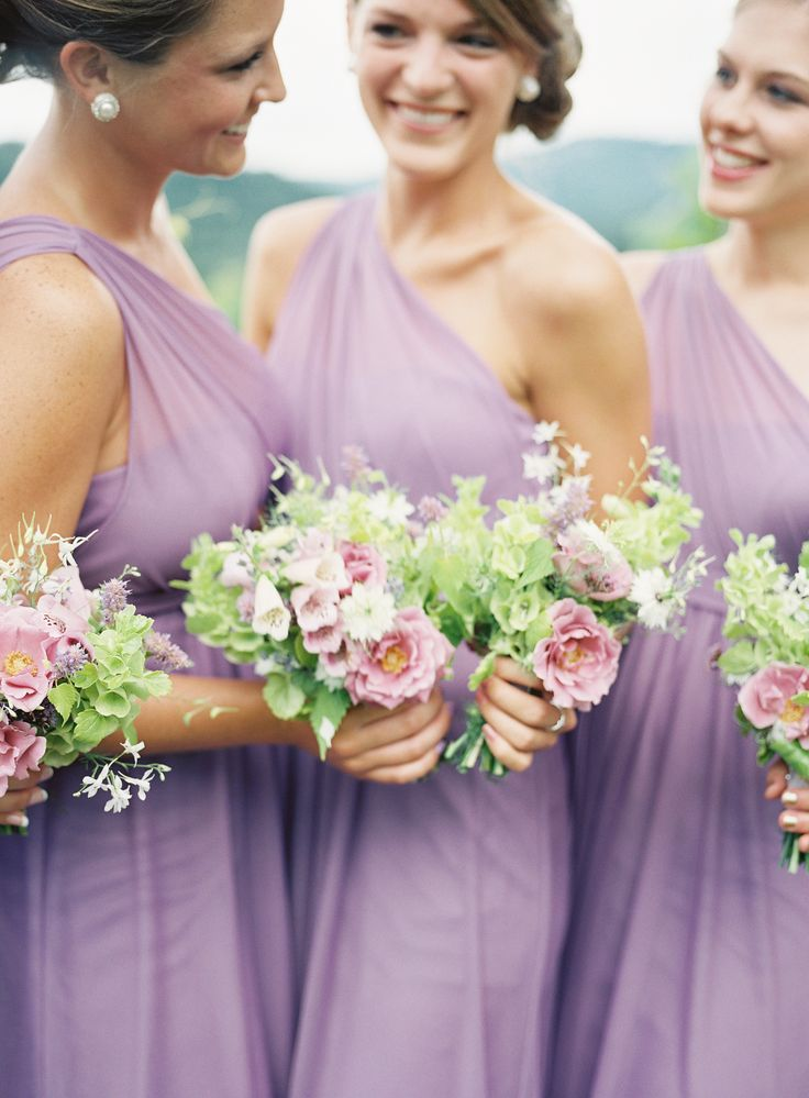Bouquets paired with David's Bridal Wisteria Purple Bridesmaid Dresses