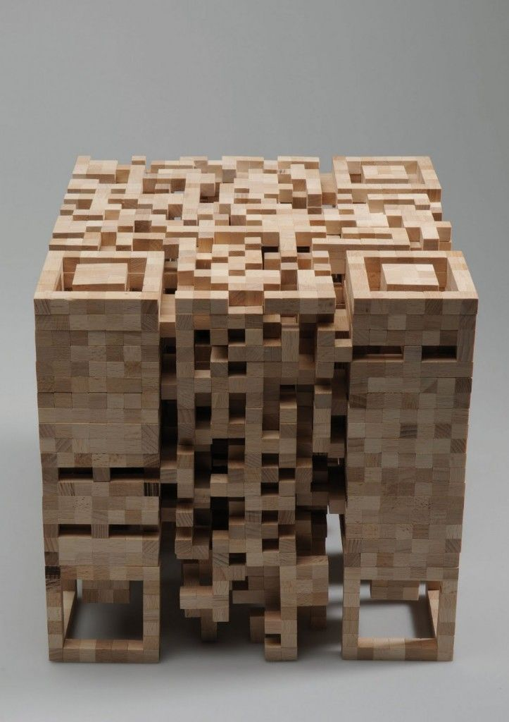 """What happens when a two dimensional QR-code is transformed into a three-dimensional structure? This is the question that German designer Elena Belmann asked herself before she created this wooden QR stool. Then she pondered """"Would this change its information content?"""" only one way to find out!  She created a wood sculpture that is part architectural form and part scannable data. This wooden structure is also a lamp. Awesome!"""