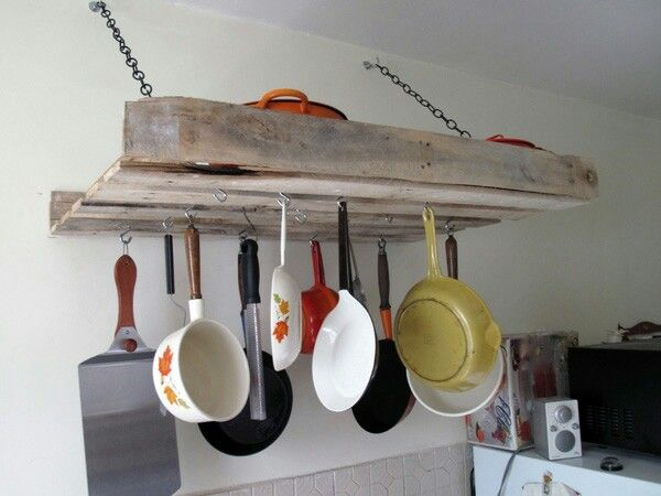 Pot and pan rack made out of an old pallet, hooks and chain. Looks easy enough to do.