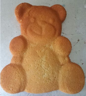 Made from our Teddy Bear cake tin - before decorating!  See Tin hire page for mor details