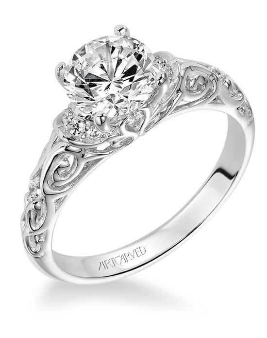 Elegant Vintage inspired diamond engagement ring with round center stone and carved u