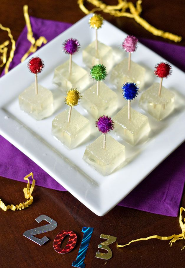 Champagne Jello Shots (Happy New Year). Ingredients: 10 oz plus 5oz champagne (or prosecco or sparkling wine), 1 tablespoon sugar, 3 envelopes Knox plain gelatin, and White sparkling sugar.