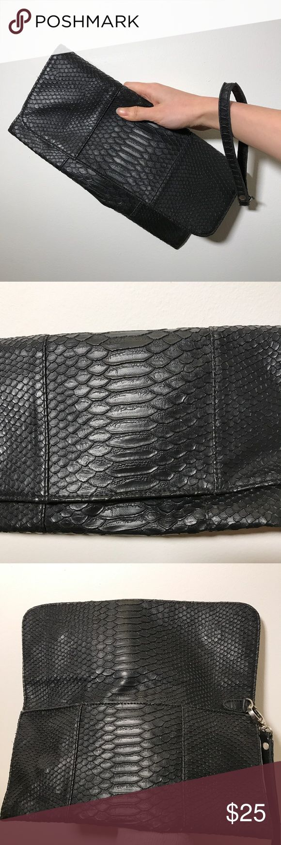 🔻Price🔻DEENA & OZZY Black Wristlet Clutch This stylish all-year-round clutch bag has snake skin embossed faux leather. Interior has one zip pocket and two open pockets, very useful! With magmatic enclosure. CONDITION: Good. No obvious sign of wear.   🙏Reasonable Offers Accepted🙏 Deena & Ozzy Bags Clutches & Wristlets