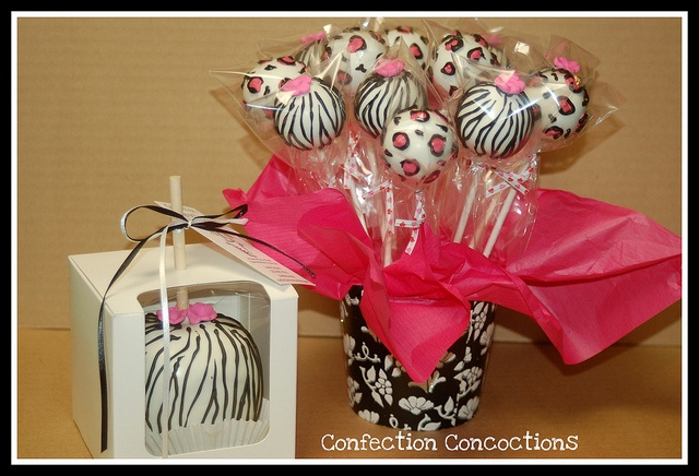 Zebra Caramel Apple and Cake Pops by Confection Concoctions, via Flickr