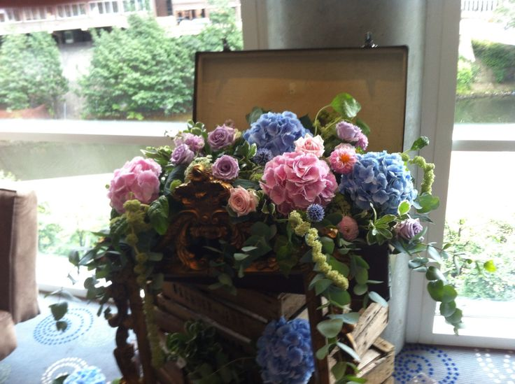 Vintage cases filled with lovely summer flowers