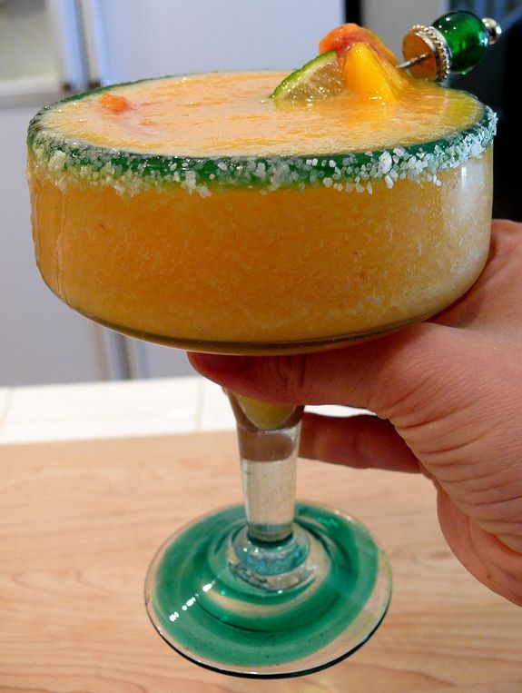 A Peach Margarita is all you need to celebrate. Frozen peaches and one secret ingredient make this frozen cocktail a favorite.