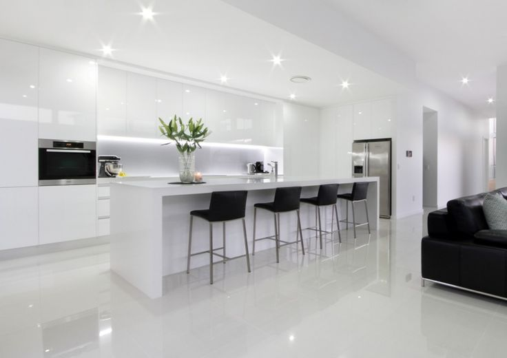 White Modern Kitchen with island bench and stools, integral lighting, no handle cupboards, gloss finish throughout