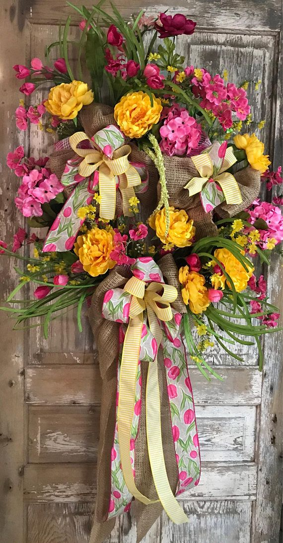 This Beautiful Grapevine Wreath will certainly bring Sunshine to your home. 52 L by 32 W.