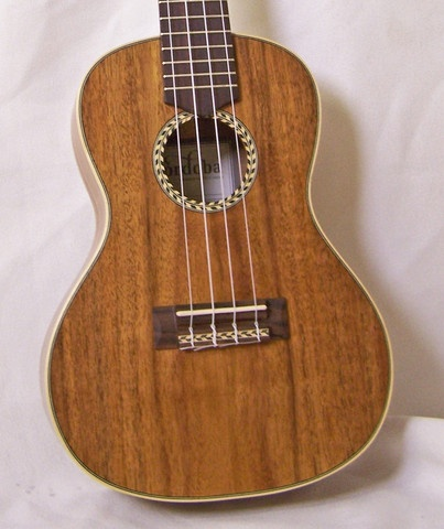 """""""The 25CK is Cordoba's Concert sized acacia ukulele. With a solid acacia top and a solid acacia back, this lightweight ukulele is a unique instrument that embodies the simple charm of traditional Portuguese ornamentation. Completely handmade and comes with a Cordoba concert sized gig bag."""""""