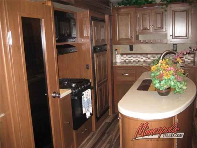 2016 New Dutchmen Rv Denali 325RL Travel Trailer in Minnesota MN.Recreational Vehicle, rv, 2016 Dutchmen RV Denali 325RL, This Dutchmen Denali rear living travel trailer has all the room and comforts from home to make any camping trip enjoyable. Model 325RL features triple slides for added interior space, a convenient island, and front bedroom, plus more.As you step inside notice the wide open living and kitchen area to the left with dual opposing slides fully extended. There is a slide…
