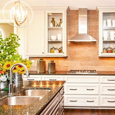 Bright spring kitchen with statement light fixture progress lighting equinox pendant